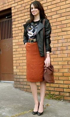 Interesting combination of black leather and terracotta-colored pencil skirt