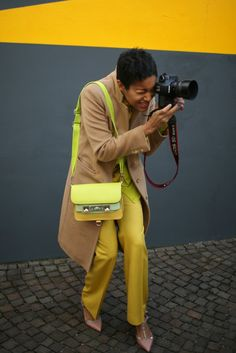 What They Are Wearing: Camel, neon green and canary yellow. Out and About at Milan Fashion Week '12. Photo by Kuba Dabrowski for WWD.