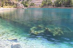 Jablanac Shipwreck -- Croatia The remains of a sunken WWII military ship wreck visible through clear water