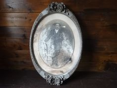 Antique French photograph of a man gentleman in ornate wood and plaster circular oval frame circa 1900's