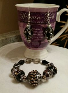 Black and silver bracelet and earrings set.