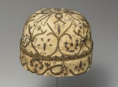 """""""""""""""Night cap late 16th–early 17th century Linen worked with silk and metal thread, spangles; speckling, running, outline, and plaited braid stitches; metal bobbin lace Dimensions: L. 5 1/2 x W. 7 1/2 inches (14 x 19.1 cm) Accession Number: 26.29 Metropolitan Museum of Art - New York"""""""""""""""