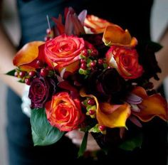 A beautiful bridal bouquet for a fall wedding, featuring roses, calla lilies, and berries in rich, warm hues. Created by a Grower Direct store in Edmonton, AB. #wedding #flowers
