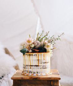 Naked cake with caramel drip with native flowers blushing bride gum white king  See this Instagram photo by @covetandgather • 277 likes