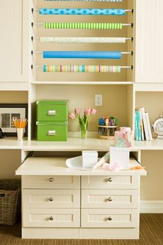 A pull out worktop in a craft room! Genius! California Closets.