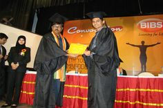 A student receiving his certificate