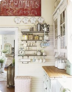 Love this shabby chic kitchen corner with vintage coffee pots, scales, and old glass containers.