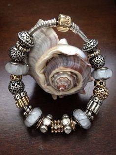 My gold and silver Pandora bracelet!! Nicole