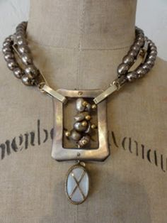 necklace ~with large metal pendant