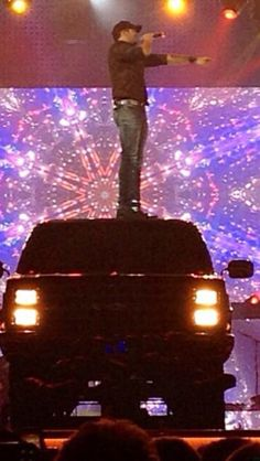 Luke Bryan & his big black jacked up truck. I want the truck!!!!!!!!!!!!!!!!!!