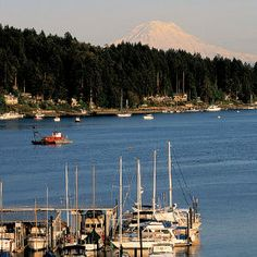 Puget Sound Living    Gig Harbor, Washington    This Washington enclave astounds newcomers with its rare beauty and rich maritime history. Tucked into the south end of Puget Sound, Gig Harbor claims unparalleled views of Mount Rainier. The town's just an hour from downtown Seattle and a few minutes across the bridge from Tacoma.
