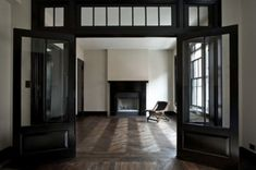 dark wood trim and doors; Love the idea of a transom over a large opening between two interior rooms