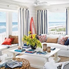 Every surface in golfer Gred Norman's Hobe Sound, Florida, beach house, from the floors to the shiplap-paneled walls, is painted white. All that white makes the ocean, which is visible from three sides of the open living space, look even bluer. Navy eleme