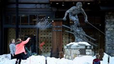 Children throw snow at the Dave McCoy statue at Mammoth Village in Mammoth Lakes. Wally Skalij / Los Angeles Times