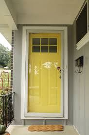 This view of a bright yellow door with a full view storm gives me an idea of how my door would look. All the inspiration photos do not have storms, but in the Midwest with a west facing house no storm doors are not an option. This door still looks good.