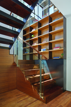 """""""The rear unit was about 90 percent rebuilt,"""" Zack says. """"We added a full floor of living space in what was the garage."""" Black walnut was used to make the home's stairs and handrails."""