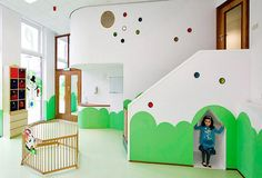 Kidtopia in Amsterdam-West | stringent day-care legislations are tweaked to create a special interior world: a curvy environment where stairs turn into slides and the director's office is also a dollhouse, and where peek-a-boo holes allow children to spy at parents