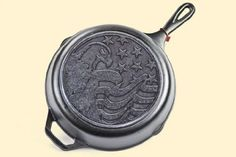 """Folks tend to enjoy our classic cast iron cookware, so we've added a patriotic twist to our class Lodge Logic'sTM cast iron cookware. Our exclusive 10 1/4"""" Skillet features an eagle and flag design on the bottom surface to truly show your pride for our country. Great gift for yourself or a dear friend. $19.99"""