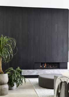 | FIREPLACES | #black #wood #marble #fireplace