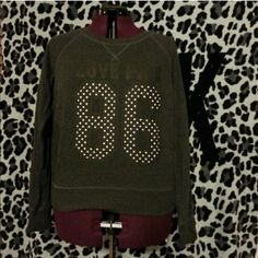 """Victoria's Secret PINK Polka Dot Sweatshirt Pre-loved Victoria's Secret PINK long sleeve sweatshirt  Size: Large  Color: Dark charcoal/ faded black  (""""LOVE PINK"""" in black writing and """"86"""" in black and white polka dots across chest)  Condition: Great  Back is plain & banded bottom PINK Victoria's Secret Sweaters Crew & Scoop Necks"""