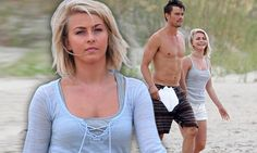 Windswept Julianne Hough has a hair-raising moment as she films beach scenes with shirtless Josh Duhamel