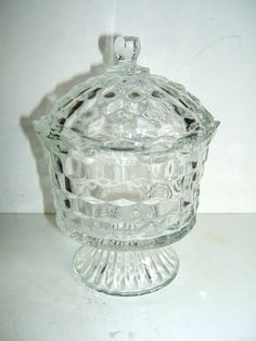 "Indiana Glass Pedestal Clear Glass Covered Dish, whitehall, vintage $7.99 + 9.85 sh THIS IS A VINTAGE PRESSED CLEAR GLASS PEDESTAL CANDY DISH WITH LID MADE BY INDIANA GLASS. THIS DISH MEASURES 8"" TALL AND 5.75"" ACROSS THE OPENING AND 4"" ACROSS THE BASE. THE DISH IS IN BEAUTIFUL CONDITION WITH NO CHIPS OR CRACKS OR ANY OTHER DAMAGE. PRE PACKAGED WEIGHT IS 2.14 POUNDS."