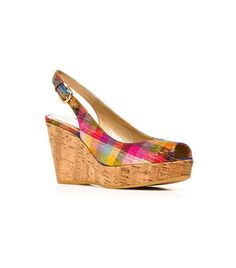 This season, the slingback peeptoe wedge is reinvented via an arresting array of materials and hues, including raffia, tinsel silk, suedes and nubuc and aniline leathers.  Adjustable buckle Heel measures approximately 3 ¾ inches with a 1 inch platform Available in pyrite nocturn, caramel leo raffia, tinsel silk, nubuc, suede, patent leather, and buck molorrus printed leather Leather footbed Rubber or cork sole Made in Spain