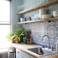 Beautiful backsplash for a contemporary kitchen. Love the colors paired with the natural open shelving!