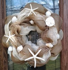burlap, shells, starfish...love how open weaved ribbon looks like fish net