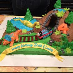 Dinosaur cake. With Thomas the Train. I don't really like the Thomas train but with a real dinosaur train train it would look good