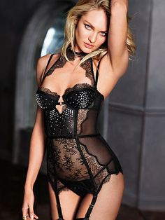 Chantilly Lace Merrywidow Very Sexy  $88 As daring as you want to be, with a sultry, high halter neck in Chantilly lace, push-up padding for sexy lift and an ultra-low back. Paired with a matching v-string panty. Push-up padding with underwire cups Adjustable straps and garters 2 back closures; 1 hook and eye closure and 1 hook closure Hits at hip Chantilly lace at adjustable halter neck, cups, front and hem Boning at front, sides and back, mesh at sides and back Matching v-string panty