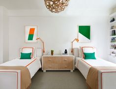A colorful design is displayed in a bedroom shared by two of the sons. Crisp…