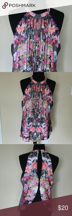 Colorful Floral & Fringe Blouse Colorful floral sleeveless blouse with open back. Fringe detail hanging from color. Never been worn. Missing one button in the back. 2 bebe brand bebe Tops Blouses