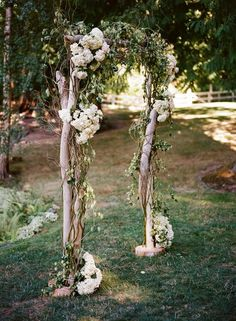 Rustic wedding ceremony idea - wooden ceremony arch with greenery and white hydrangeas  {Julianna J Photography}