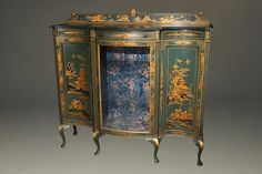 """Exquisite Antiques: This 1920s antique cabinet crafted for storage and display features a stunning Chinoiserie finish. The green polychrome is complimented with lovely scenes of Chinese mountainside village life, and finished with lacquer. The unique look of this antique cabinet would add quite a bit of """"wow"""" to an entryway, dining room or living room! Learn more on our website. #antiques #furniture"""