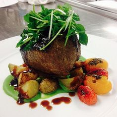 """I'm always happy to see the elegant dishes that my catering team has put together. #regram """"@wpcsunsetroom - Pan Seared NY strip over roasted smoked fingerling potatoes with blistered heirloom tomatoes and Spring Pea Purée"""" #wpcsunsetroom #chefgranthall #wpcatering #farmtotable #summerwithwolfgang"""