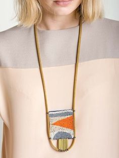 Solo dancer necklace by Lizzie Fortunato. I like the simple geometric pattern. $300