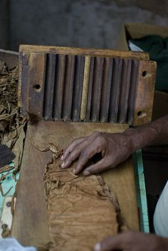HANDMADE CIGARS; To make handmade cigars, the bales of cigar tobacco are brought into the rolling factory and placed in a temperature and humidity controlled area.