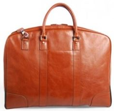 Jekyll & Hide Zulu Leather Suiter Cognac R6050 A beautiful and classy leather garment bag.  Jekyll & Hide genuine leather pieces are created for a life lived authentically. And like authenticity, leather is rare and valuable. It is also a natural expression of beauty and enduring luxury. Leather Pieces, Zulu, Authenticity, Classy, Tote Bag, Luxury, Natural, Bags, Life
