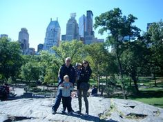 Family portrait in front of the NYC skyline; on one of the boulders in Central Park