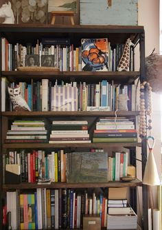 A cool bookshelf with odds and ends.