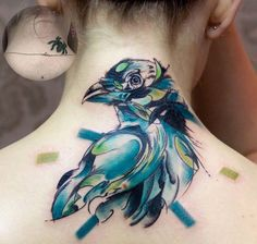 Watercolor bird cover up tattoo - Looking really carefully, you could see parts of the spider's body perfectly camouflaged into the head and neck of the new tattoo which is a bird. Nonetheless, it wouldn't really appear unless you're looking for it. And the popping colors of the new tat would really make you feel like you don't have to.