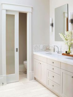 Small Bathroom Remodel: An Airy Retreat frosted glass door on bathroom pocket doors Bathroom Doors, Bathroom Renos, Bathroom Renovations, Bathroom Pocket Door, Bathroom Ideas, Bathroom With Closet, Frosted Glass Door Bathroom, Water Closet Decor, Basement Bathroom