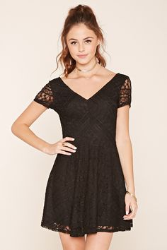 A short length crochet lace dress featuring an A-line silhouette, short sleeves, a V-neckline, and a hidden side zipper.