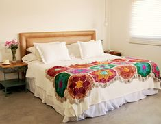 Love this vintage looking crochet quilt on all white