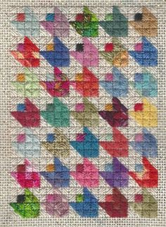 Scrap Bag Tulips Free Needlepoint Project uses odds & ends of thread in a quilt-inspired ornament. By needlepoint expert Janet M Perry.