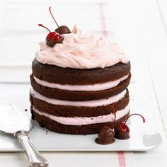 Creamy cherry-flavor frosting is layered between tiers of rich and luxurious chocolate cake. More chocolate desserts: http://www.bhg.com/recipes/desserts/chocolate/chocolate-recipes/?socsrc=bhgpin052913stackcake=15 chocolate cake recipes, chocolate desserts, valentine day, valentine cake, dessert recipes, layer cakes, decadent desserts, decadent chocolate, chocolate cakes