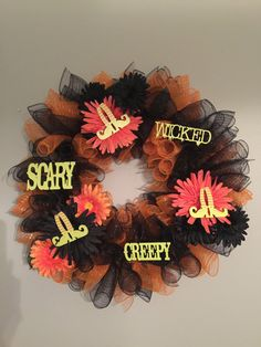 Are you ready for Halloween? Show your spooky spirit with this custom made Spooky Wreath.  Show your Halloween Spirit with this 24 Deco Mesh Wreath. This wreath includes Orange and Black Tubular Shaped Deco Mesh and Orange and Black Accent Flowers. It is accented with Lime Green Wood Word Accents of Scary, Creepy, and Wicked. This wreath can be customized for any holiday.  Order your wreath and mailbox bow together to save $10.00. (Wreath and bow total=$90)  I custom make each wreath to ...