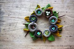 lil fish studios: nesting brooches. Wee nests of wool.