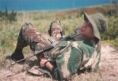 Bermuda Regiment soldier playing OPFOR with a Choate modified Mini-14 (purchased to replace the SLR instead of the L85A1), DPM pants, and a rare Pattern 59 Denison Smock, mid-1990s.